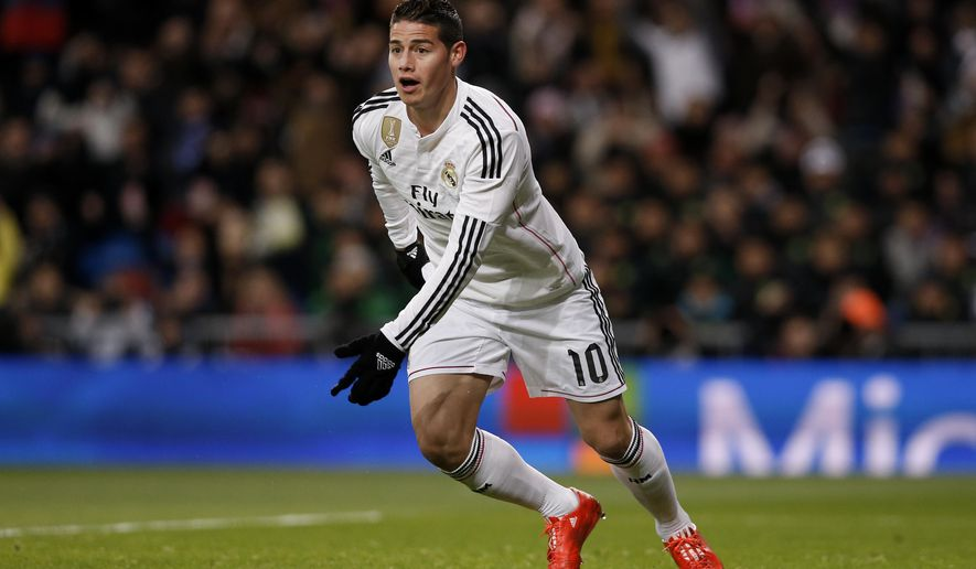 James Rodriguez from Colombia celebrates after scoring a goal during a Spanish La Liga soccer match between Real Madrid and Sevilla at the Santiago Bernabeu stadium in Madrid, Spain, Wednesday, Feb. 4, 2015. (AP Photo/Daniel Ochoa de Olza)