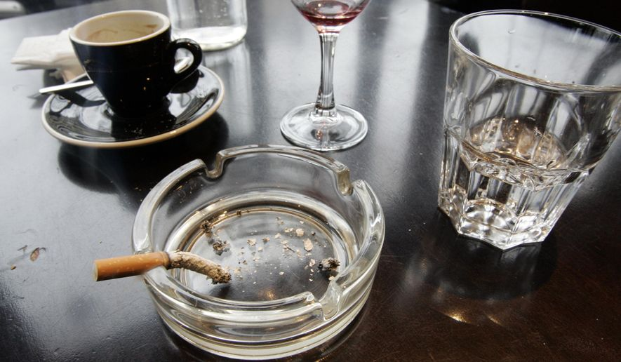 A cigarette burns out in an ashtray after lunch at a restaurant in Paris in this Dec. 27, 2007, file photo. According to a report released on Wednesday, Feb. 4, 2015, for the first time, lung cancer has passed breast cancer as the leading cause of cancer deaths for women in rich countries, according to the American Cancer Society based on new numbers from the International Agency for Research on Cancer. (AP Photo/Francois Mori)