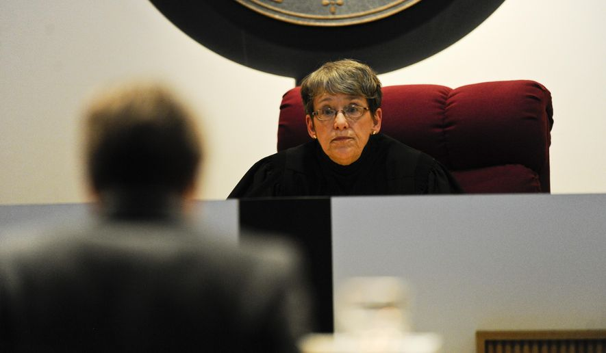 Justice Patricia Cotter listens as Assistant Attorney General Tammy Plubell argues the 100-year, no-parole sentence was legal and there is no reason to overturn it, Wednesday Feb. 4, 2015 in the Montana Supreme Court Room in Helena, Mont. (AP Photo/Independent Record, Thom Bridge)