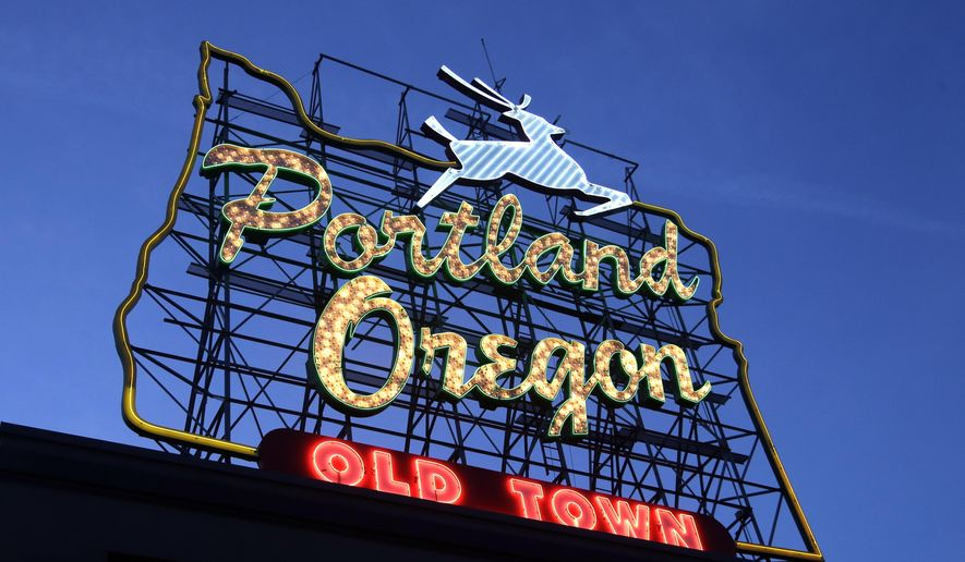 "This Tuesday, Jan. 27, 2015 photo shows the ""Portland, Oregon"" sign in downtown Portland, Ore. The city and Pabst in a dispute over the brewer's use of the iconic sign to promote a music festival. (AP Photo/Don Ryan)"