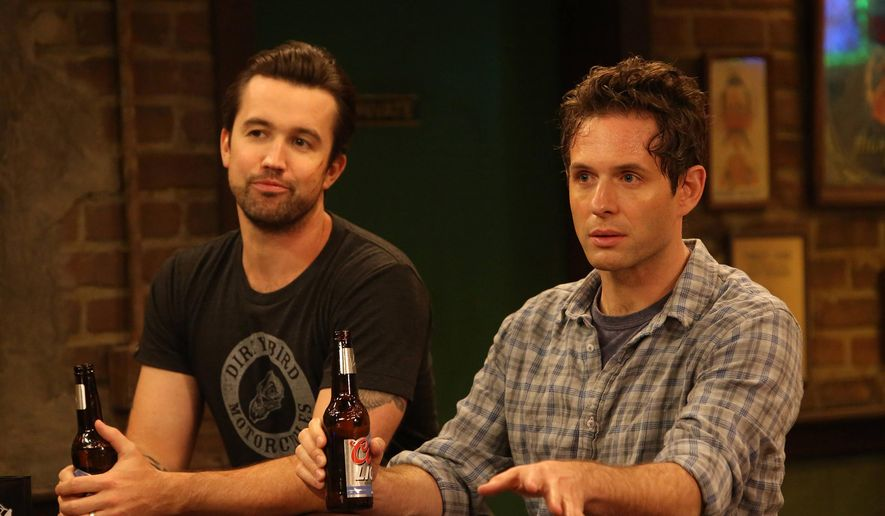 """This photo provided by FX shows, Rob McElhenney, left, as Mac, and Glenn Howerton as Dennis in a scene in episode 4 of """"Charlie's Work"""" from the television series, """"It's Always Sunny in Philadelphia,"""" airing Wednesday, Feb. 4, 2015, at 10:00 p.m. ET/PT.  (AP Photo/FX, Patrick McElhenney)"""