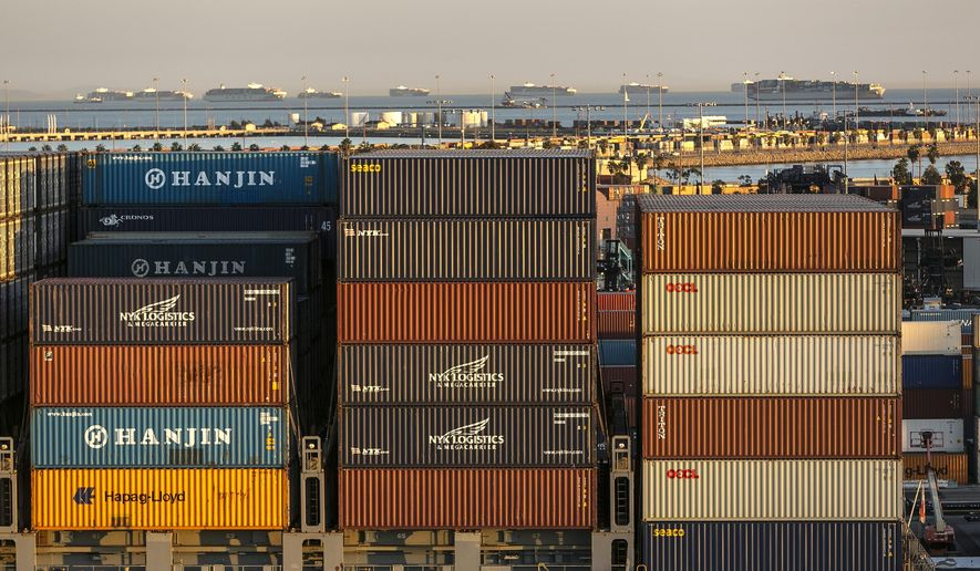 In this Jan. 14, 2015, file photo, incoming container ships line up outside the Port of  Los Angeles as they await for dock space. Employers could lock out West Coast dockworkers in as few as five days if the two sides do not reach a new contract. That warning came Wednesday, Feb. 4, 2015, from the head of a maritime association who is negotiating a new deal with a union representing longshoremen at 29 ports that handle about $1 trillion in trade annually. (AP Photo/Damian Dovarganes, File)