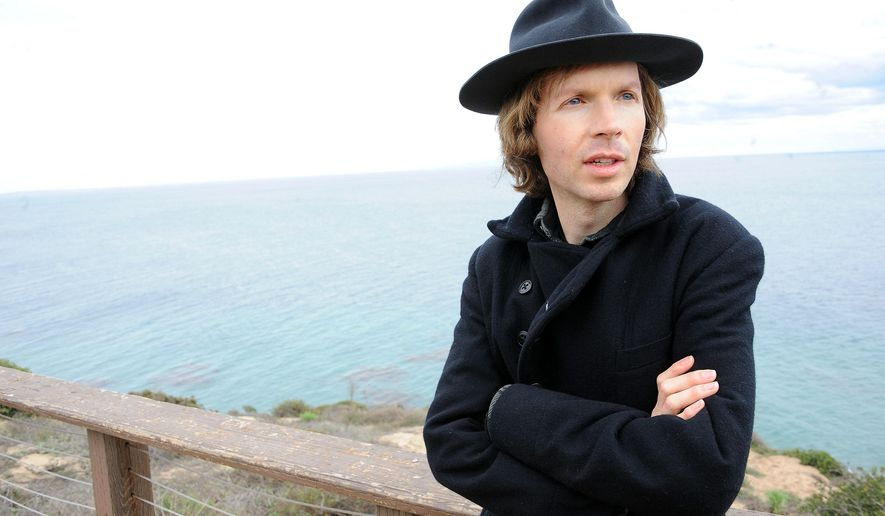 FILE - In this Dec. 14, 2012 file photo, musician Beck poses for a portrait at his home, in Malibu, Calif. Beck  Ed Sheeran, Sam Smith and the Electric Light Orchestra are among a new batch of performers added to the bill for Sunday night's Grammy Awards. The Grammys continue their signature of pairing artists for special one-time performances. Beck will take the stage with Coldplay's Chris Martin. (Photo by Katy Winn/Invision/AP, File)