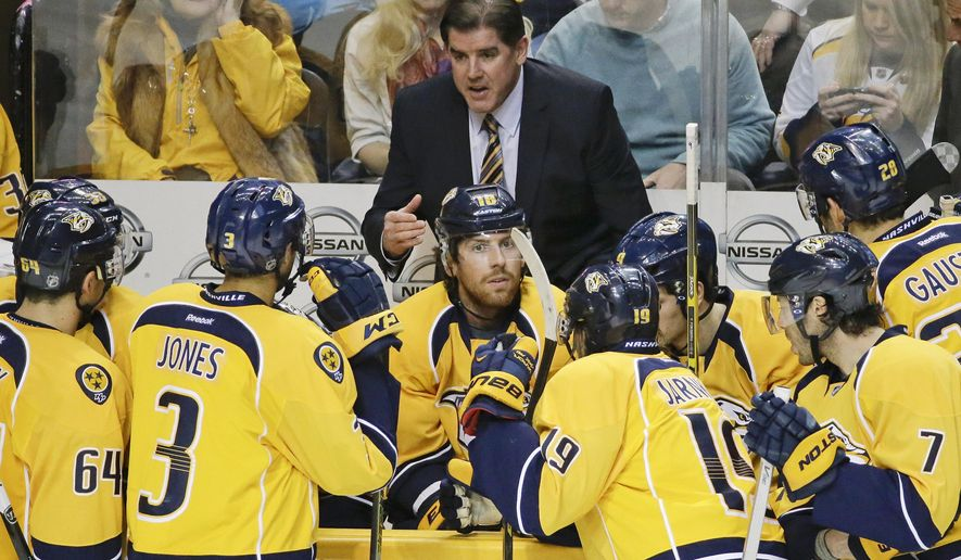 Nashville Predators head coach Peter Laviolette talks to his players during a timeout in the third period of an NHL hockey game against the Toronto Maple Leafs Tuesday, Feb. 3, 2015, in Nashville, Tenn. The Predators won 4-3. (AP Photo/Mark Humphrey)