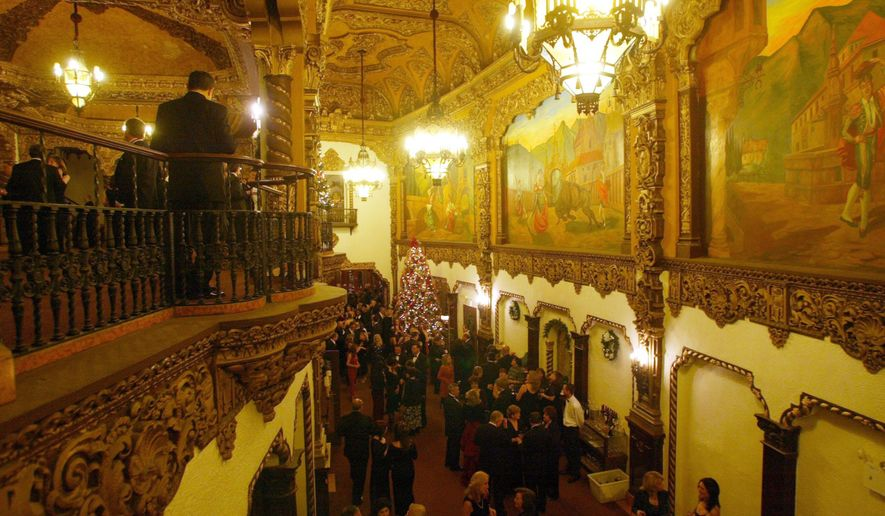 In this Dec. 4, 2005 photo, a black-tie crowd gathers in the St. George Theatre in the Staten Island borough of New York. The St. George Theatre opened in 1929 as a movie-and-vaudeville house that featured live performers like Al Jolson, Kate Smith and Guy Lombardo. Its grand interior is decorated in a Spanish-Italian baroque style with ornate chandeliers, balconies with cast-iron railings, ceilings and walls covered in intricate gold-leaf and plaster designs. (AP Photo/ Staten Island Advance, Jin Lee)