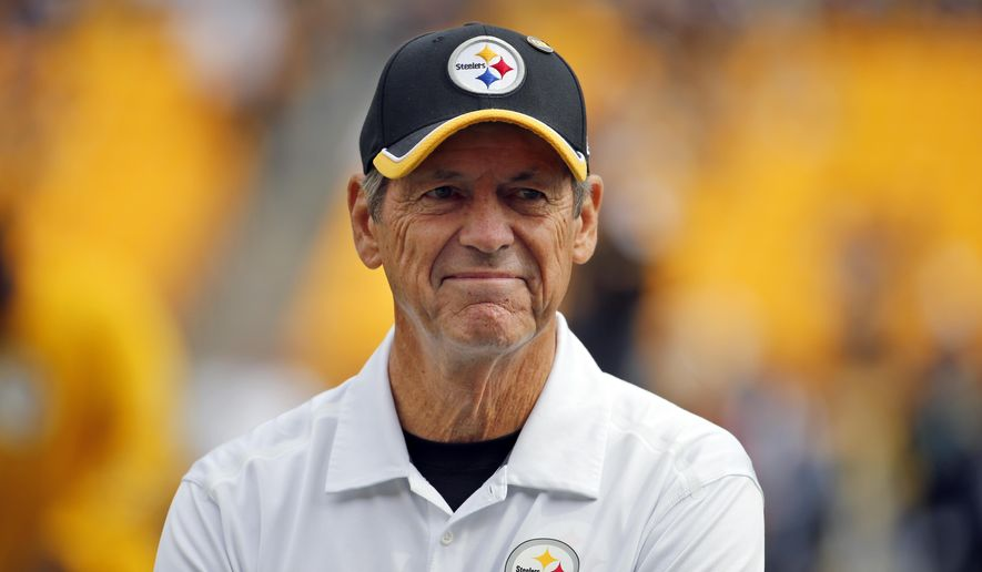 "FILE- In this Sept. 28, 2014, file photo, Pittsburgh Steelers defensive coordinator Dick LeBeau watches during warm ups before an NFL football game against the Tampa Bay Buccaneers in Pittsburgh. Pittsburgh is honoring the former Steelers defensive coordinator by dubbing February ""Dick LeBeau Month."" The 77-year-old coach resigned last month and was honored Tuesday, Feb. 3, 2015, by the Pittsburgh City Council. (AP Photo/Gene Puskar, File)"
