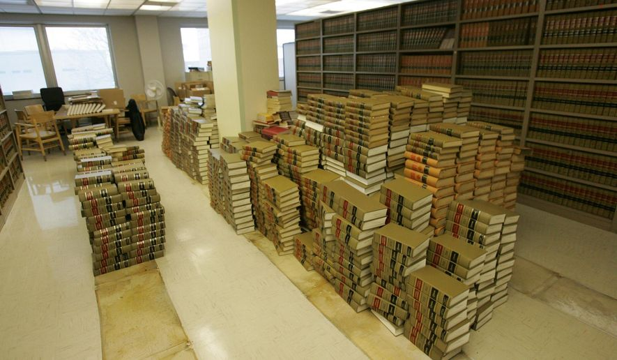 Books are piled up at the Black Hawk County law library on Jan. 29, 2015 in Waterloo, Iowa. The library is being dismantled as the Internet provides information once available only in law books.  The Board of Supervisors voted last week to let the district court dispose of the law books and legal publications that fill high shelves. Officials are offering the books to the Waterloo Public Library, local governments and attorneys.   (AP Photo/Waterloo Courier, Dennis Magee)