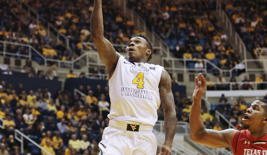 West Virginia guard Daxter Miles Jr. (4) out runs Texas Tech guard Toddrick Gotcher (20) on a fast break to score 2-points during the second half of an NCAA college basketball game, Saturday, Jan. 31, 2015, in Morgantown, W.Va. West Virginia defeated Texas Tech 77-58. (AP Photo/Raymond Thompson)