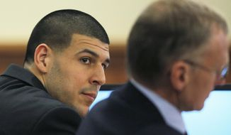 Former NFL football player Aaron Hernandez, left,  and his attorney Charles Rankin listen to testimony during Hernandez' murder trial  at Bristol County Superior Court in Fall River, Mass., Wednesday, Feb. 4, 2015. Hernandez is accused of the June 2013 killing of Odin Lloyd.   (AP Photo/Brian Snyder, Pool)