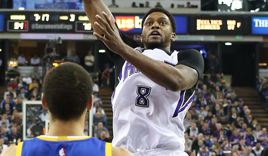 Sacramento Kings forward Rudy Gay shoots over Golden State Warriors guard Stephen Curry during the third quarter of an NBA basketball game  in Sacramento, Calif., Tuesday, Feb. 3, 2015. The Warriors won 121-96. (AP Photo/Rich Pedroncelli)