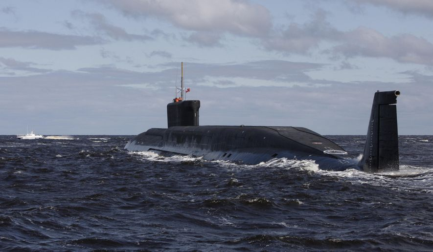 This Thursday, July 2, 2009, file photo, shows a new Russian nuclear submarine, Yuri Dolgoruky, near the Sevmash factory in the northern city of Arkhangelsk, Russia. (AP Photo/Alexander Zemlianichenko, File)