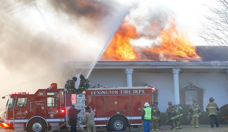 Lexington Fire Department firefighters respond to a fire at the Thoroughbred Center, Wednesday, Feb. 4, 2015, in Lexington, Ky. The Lexington Herald-Leader reports no horses were hurt in the fire. (AP Photo/Lexington Herald-Leader, Charles Bertram)