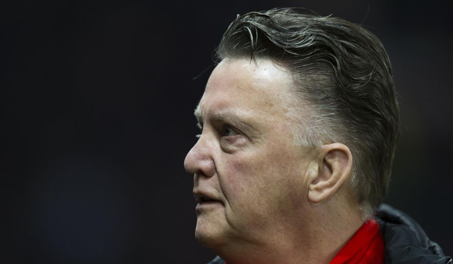Manchester United's manager Louis van Gaal takes to the touchline before his team's English FA Cup fourth-round replay soccer match between Manchester United and Cambridge at Old Trafford Stadium, Manchester, England, Tuesday Feb. 3, 2015. (AP Photo/Jon Super)