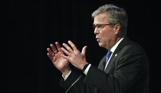 Jeb Bush speaks to the Detroit Economic Club on Wednesday, Feb. 4, 2015, at Cobo Center in Detroit. (AP Photo/The Grand Rapids Press, Elaine Cromie)