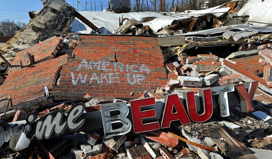 This photo taken on Tuesday, Feb. 3, 2015, shows what remains of Prime Beauty which was destroyed during protests and rioting following the fatal police shooting of Michael Brown, in Dellwood, Mo. St. Louis County has allocated $500,000 to help Ferguson and surrounding communities raze and rebuild property that were damaged in the aftermath of the shooting. (AP Photo/St. Louis Post-Dispatch, J.B. Forbes)