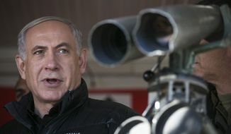Israel's Prime Minister Benjamin Netanyahu visits at a military outpost during a visit at Mount Hermon in the Israeli-controlled Golan Heights overlooking the Israel-Syria border on Wednesday, Feb. 4, 2015. (AP Photo/Baz Ratner, Pool)