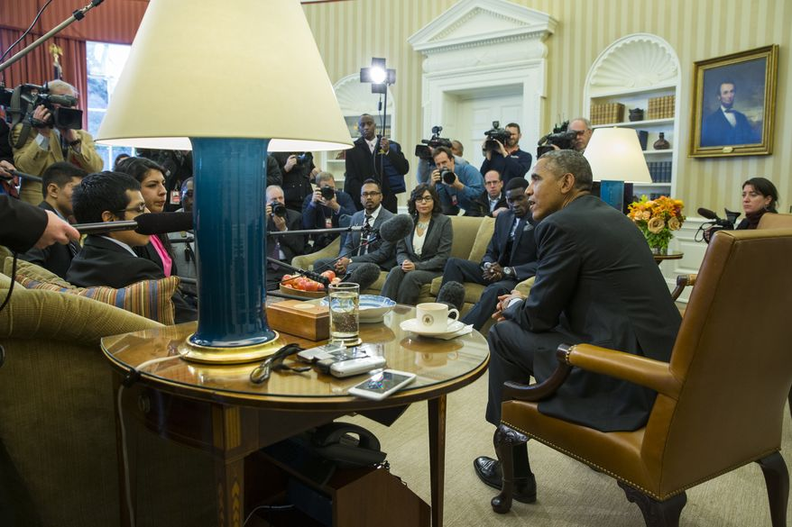 """President Barack Obama meets with a group of """"Dreamers"""" in the Oval Office of the White House in Washington on Feb. 4, 2015. (Associated Press **FILE**"""