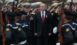 FILE - In this Friday, May 9, 2014 file photo Russian President Vladimir Putin attends a  parade marking the Victory Day in Sevastopol, Crimea. With hundreds of new aircraft, tanks and missiles rolling off assembly lines and Russian jets buzzing European skies under NATO's wary eye, it doesn't look like Russia's economic woes have had any impact on the Kremlin's ambitious military modernization program. (AP Photo/Ivan Sekretarev, File)