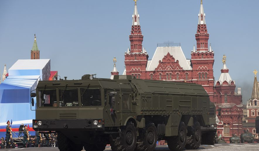 FILE - In this Tuesday May 7, 2013 file photo, Russian Iskander missiles make their way through Red Square during a rehearsal for the Victory Day military parade in Moscow, Russia. With hundreds of new aircraft, tanks and missiles rolling off assembly lines and Russian jets buzzing European skies under NATO's wary eye, it doesn't look like Russia's economic woes have had any impact on the Kremlin's ambitious military modernization program. (AP Photo/Alexander Zemlianichenko, File)