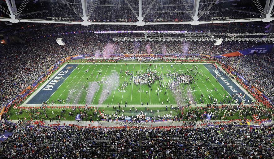 Players celebrate after the NFL Super Bowl XLIX football game between the Seattle Seahawks and the New England Patriots Sunday, Feb. 1, 2015, in Glendale, Ariz. (AP Photo/Morry Gash)