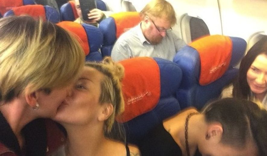Lesbian activists who happened to be seated on a plane in front of Russian lawmaker Vitaly Milonov decided to photograph themselves kissing and poking fun at the man behind Russia's controversial anti-gay propaganda law. (Ksenia Infinity via CNN)