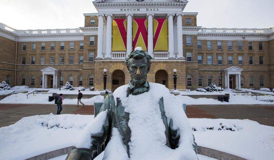 This Feb. 4, 2015, photo shows a Abraham Lincoln statue on Bascom Hill on the University of Wisconsin-Madison campus in Madison, Wis. The University of Wisconsin System regents are pushing back against Republican Gov. Scott Walker's proposed budget cuts. (AP Photo/Wisconsin State Journal, Steve Apps)