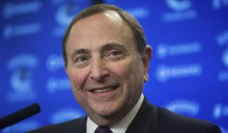 NHL Commissioner Gary Bettman pauses responds to questions during a news conference, Friday, Jan. 30, 2015 in Vancouver, British Columbia. (AP Photo/The Canadian Press, Darryl Dyck)