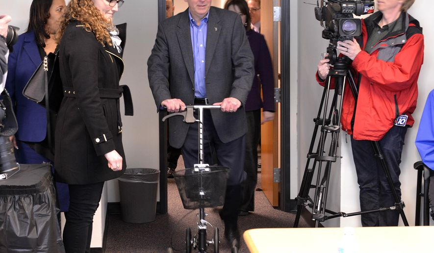 FILE- In this Jan. 26, 2015 file photo, Michigan Gov. Rick Snyder, who has an injured ankle, arrives on his scooter before he addresses the state's Civil Rights Commission in Lansing, Mich. The governor has been hospitalized with a blood clot in his right leg, about a month after tearing his Achilles tendon while jogging. Snyder spokeswoman Sara Wurfel says the 56-year-old governor was admitted to St. Joseph Mercy Hospital near Ann Arbor late Thursday, Feb. 5. The governor had noticed swelling in his leg, and doctors determined it was a blood clot. (AP Photo/Detroit News, Dale G. Young, FILE) DETROIT FREE PRESS OUT; HUFFINGTON POST OUT