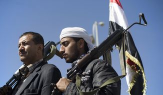 Houthi Shiite Yemenis hold their weapons during a rally to show support for their comrades in Sanaa, Yemen, Wednesday, Feb. 4, 2015. The Houthis' power grab has plunged Yemen into a deep political crisis. (AP Photo/Hani Mohammed)