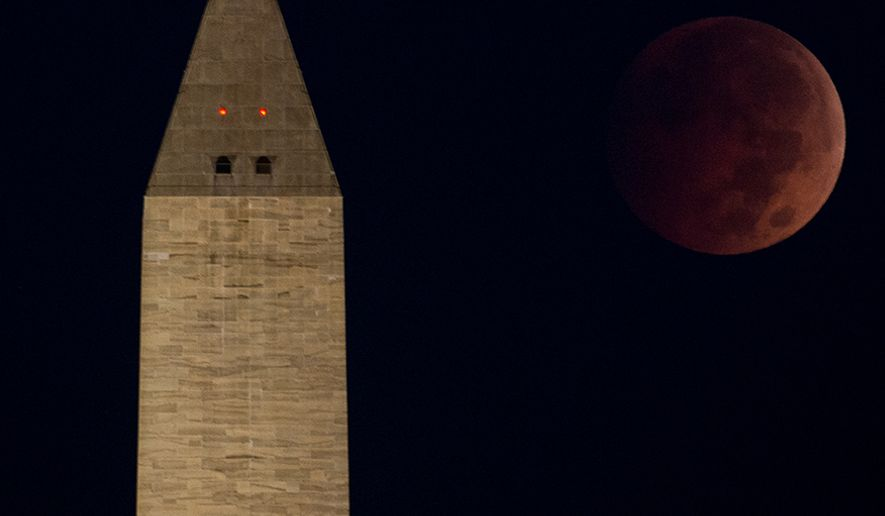 "A ""blood moon"" or lunar eclipse can be seen above the Washington Monument just before dawn on the National Mall, Washington, D.C., Wednesday, October 8, 2014. The lunar eclipse is the second and last of 2014. (Andrew Harnik/The Washington Times)"