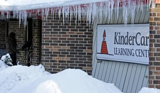 Icicles line the exterior of KinderCare Learning Center on East Palatine Road, Thursday, Feb. 5, 2015, in Palatine, Ill. Public health officials say students, staff and faculty at the facility have been notified and anyone who hasn't been vaccinated for measles has been instructed to stay away from unvaccinated individuals for the next three weeks after lab tests confirm measles in children from the day care. (AP Photo/Nam Y. Huh)