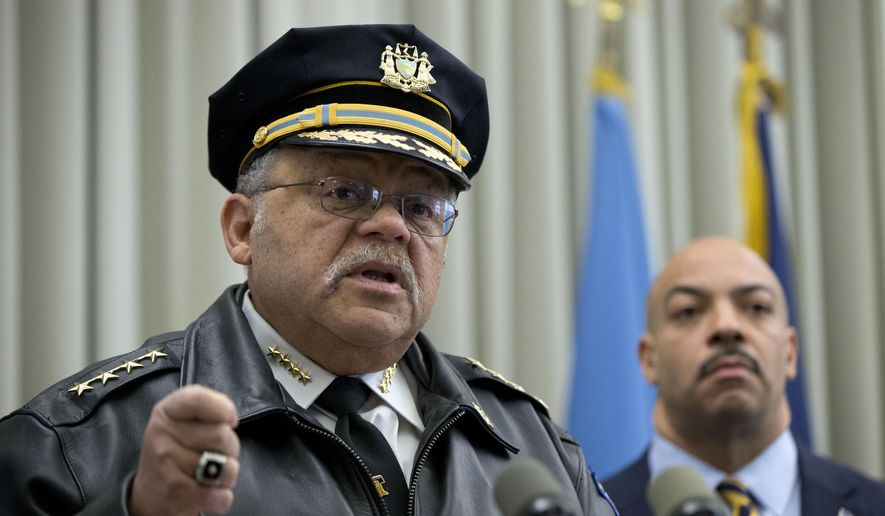 Philadelphia Police Commissioner Charles Ramsey, left, speaks as District Attorney Seth Williams listens during a news conference Thursday, Feb. 5, 2015, in Philadelphia. Two Philadelphia police officers face brutality charges after prosecutors say they knocked a man off a scooter and beat him so severely another officer thought the bloodied man had been shot. (AP Photo/Matt Rourke)