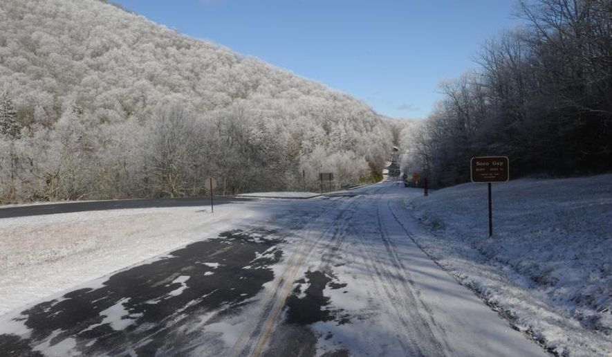 ADVANCE FOR USE SATURDAY, FEB. 7 - This undated photo shows shows the Blue Ridge Parkway dusted with snow at Soco Gap west of Asheville, N.C. The next best thing to a crystal ball that Chief Ranger Neal Labrie has in his arsenal is the parkway's interactive road closure website.  (AP Photo/The Asheville Citizen-Times, John Fletcher)  NO SALES