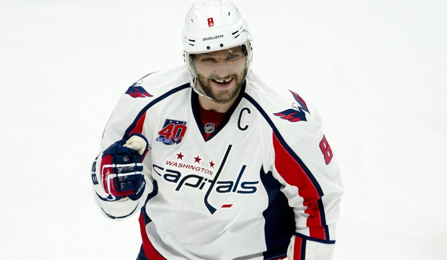 Washington Capitals left wing Alex Ovechkin celebrates his goal against the Ottawa Senators during the second period on an NHL hockey game, Thursday, Feb. 5, 2015 in Ottawa, Ontario. (AP Photo/Canadian Press, Adrian Wyld)