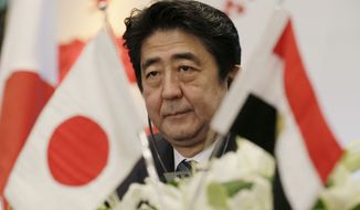 """In this Jan. 17, 2015 file photo, Japanese Prime Minister Shinzo Abe attends a joint meeting of the Japan-Egypt business committee in Cairo, Egypt. Behind the sympathy Japanese are voicing over their two countrymen purportedly slain by the Islamic State group is a widespread view that they were """"troublemakers."""" (AP Photo/Hassan Ammar, File)"""