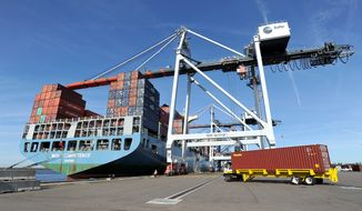 In this Jan. 6, 2015 photo, the MOL Competence, a 1036-foot long, 150-foot wide container ship carrying 45,000 tons of cargo, is moored at the TraPac Container Terminal in Jacksonville, Fla. The Commerce Department reports on the U.S. trade deficit for December on Thursday, Feb. 5, 2015. (AP Photo/The Florida Times-Union, Bruce Lipsky)