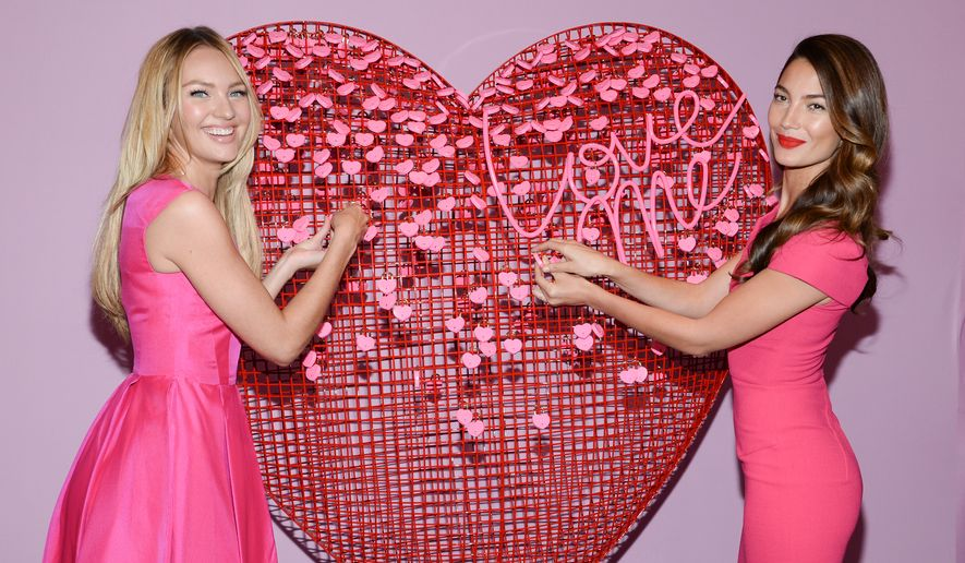 Victoria's Secret Angels Candice Swanepoel, left, and Lily Aldridge pose during a Valentine's Day gift idea photo call  at Victoria's Secret Herald Square on Thursday, Feb. 5, 2015, in New York. (Photo by Evan Agostini/Invision/AP)