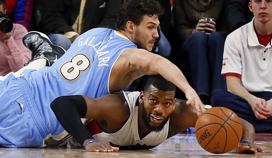 Denver Nuggets forward Danilo Gallinari (8) and Detroit Pistons forward Greg Monroe (10) dive for a loose ball during the second half of an NBA basketball game in Auburn Hills, Mich., Friday, Feb. 6, 2015. (AP Photo/Paul Sancya)