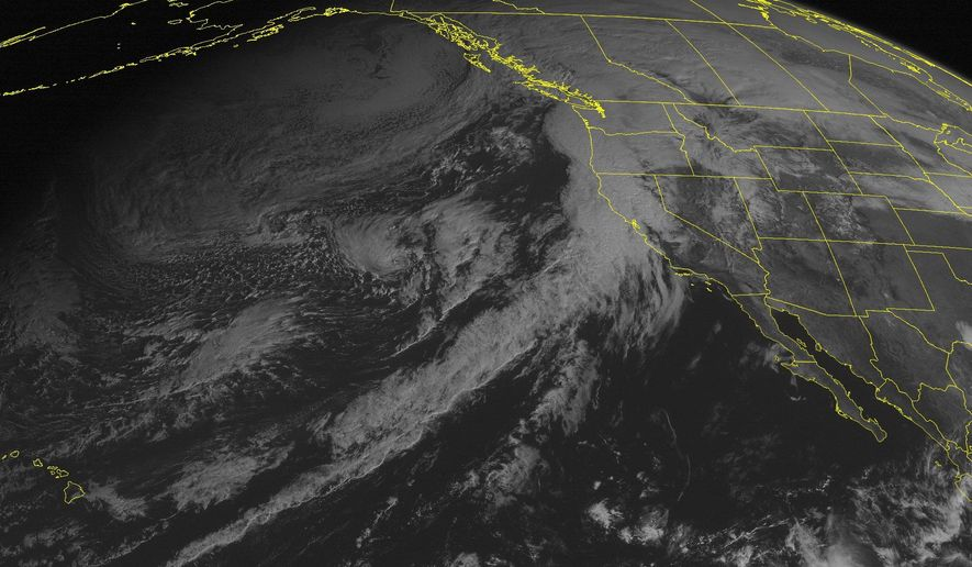 This NOAA satellite image taken Friday, Feb. 6, 2015 at 1:00 p.m. EST, shows a line of clouds entering into the Pacific Northwest and northern California as a storm moves into the area, with rain. Clouds are occurring over the Intermountain West, Northern Rockies, and eastern Great Basin as well as portions of the Northern Plains. (AP Photo/Weather Underground)