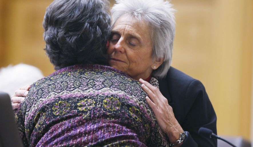 Colorado Rep. Joann Ginal, right, D-Fort Collins, hugs Carol Stork of Delta, Colo., after her testimony about the death of her terminally-ill husband, Albert, on Jan. 2, during a Colorado legislative hearing on a bill proposal by Ginal that would give dying patients the option to seek help ending their lives Friday, Feb. 6, 2015, in Denver. Dozens of people with serious illnesses and others who have seen relatives suffer were on hand for the first public hearing on the measure, which would put Colorado among a handful of states currently considering laws to allow the terminally ill to get doctor-prescribed medication to die. (AP Photo/David Zalubowski)