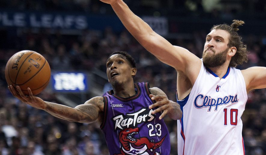 Toronto Raptors guard Louis Williams (23) drives past Los Angeles Clippers forward Spencer Hawes (10) during the first half on an NBA basketball game, Friday, Feb. 6, 2015 in Toronto. (AP Photo/Canadian Press, Nathan Denette)
