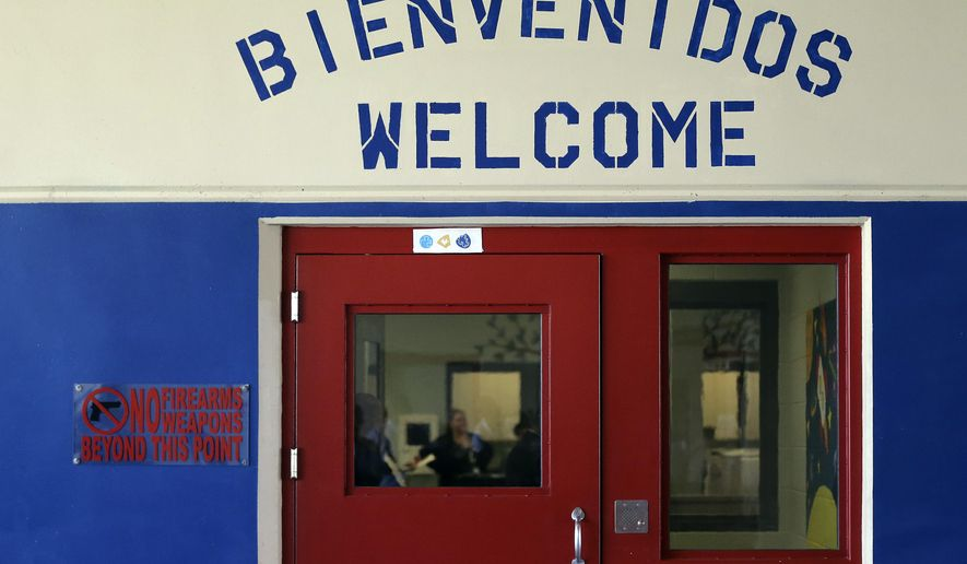 File - In this July 31, 2014 file photo, a Spanish and English welcome sign is seen above a door in a secured entrance area at the Karnes County Residential Center in Karnes City, Texas. The Department of Homeland Security released a report Friday, Feb. 6, 2015 saying no evidence of sexual abuse and harassment was found at a South Texas immigration lockup that houses women and children. (AP Photo/Eric Gay, File)