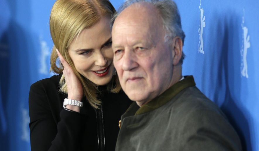 Actress Nicole Kidman and director Werner Herzog pose during the photo call for the film Queen of The Desert at the 2015 Berlinale Film Festival in Berlin Friday, Feb. 6, 2015. (AP Photo/Michael Sohn)