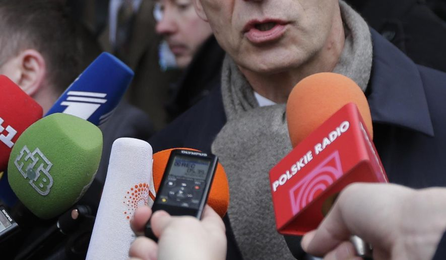 NATO Secretary General Jens Stoltenberg answers questions of journalists as he arrives for the 51. Security Conference in Munich, Germany, Friday, Feb. 6, 2015. The conference on security policy takes place from Feb. 6, 2015 until Feb. 8, 2015. (AP Photo/Matthias Schrader)