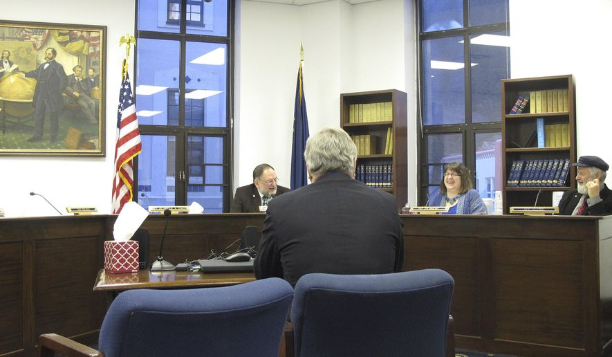 Reps. Wes Keller, from left to right rear, Harriet Drummond and Paul Seaton, members of the House Education Committee, laugh during a hearing on a bill that would require Alaska school districts to teach American constitutionalism, on Friday, Feb. 6, 2015, in Juneau, Alaska. Also pictured is Keller's aide Jim Pound, foreground. Alaska lawmakers are considering a bill that would require school districts to teach American constitutionalism, the latest of several state government measures across the U.S. aimed at civics education. The House Education Committee heard Friday from members of the public who supported the bill, including some former educators. (AP Photo/Molly Dischner)