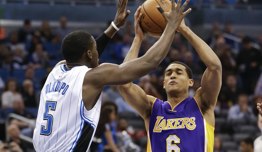 Los Angeles Lakers' Jordan Clarkson (6) goes to the basket against Orlando Magic's Victor Oladipo (5) during the first half of an NBA basketball game, Friday, Feb. 6, 2015, in Orlando, Fla. (AP Photo/John Raoux)