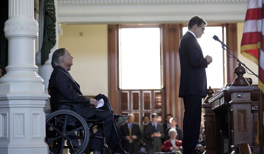 FILE - In this Monday, Jan. 5, 2015 file photo, Gov.-elect Greg Abbott, left, listens to Gov. Rick Perry speak during an oath of office ceremony for new Attorney General Ken Paxton, in Austin, Texas. Barely two weeks into office, Abbott has scrapped or reformed legacies of the former governor, who is a potential 2016 presidential candidate. University boards are no longer exclusively stocked with Perry picks and transparency - something critics said Perry lacked - has become an early Abbott theme. (AP Photo/Eric Gay)