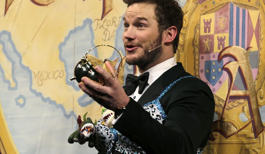 "Actor Chris Pratt holds up his pudding pot trophy during a roast at Harvard University, in Cambridge, Mass., Friday, Feb. 6, 2015, Pratt, star of the film ""Guardians of the Galaxy"", was honored as ""Man of the Year"" by the Hasty Pudding Theatricals at Harvard University. (AP Photo/Charles Krupa)"