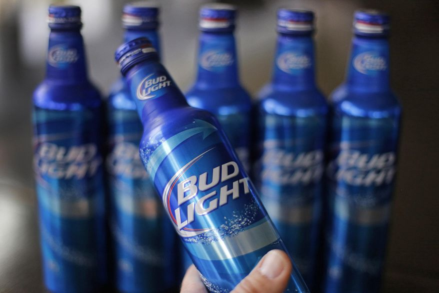 In this Monday, April 7, 2014, file photo, aluminum bottles of Bud Light beer are on display at Alcoa headquarters in Pittsburgh. (AP Photo/Gene Puskar, File)