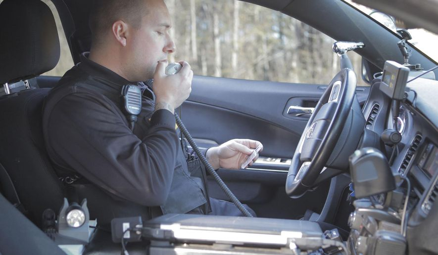 Senior Cpl Bryan Rulong patrols the stretch of I-95 running through Sumter County, S.C. on Jan. 30, 2015.  Every day an army of smugglers traffic illegal narcotics and large amounts of cash, using the 1,900-mile artery to ferry their stashed loads through the county, state and region. Drug experts say the I-95 pipeline is notorious for the role it plays in the American drug trade and has been so for decades.  (AP Photo/The Item, Keith Gedamke)